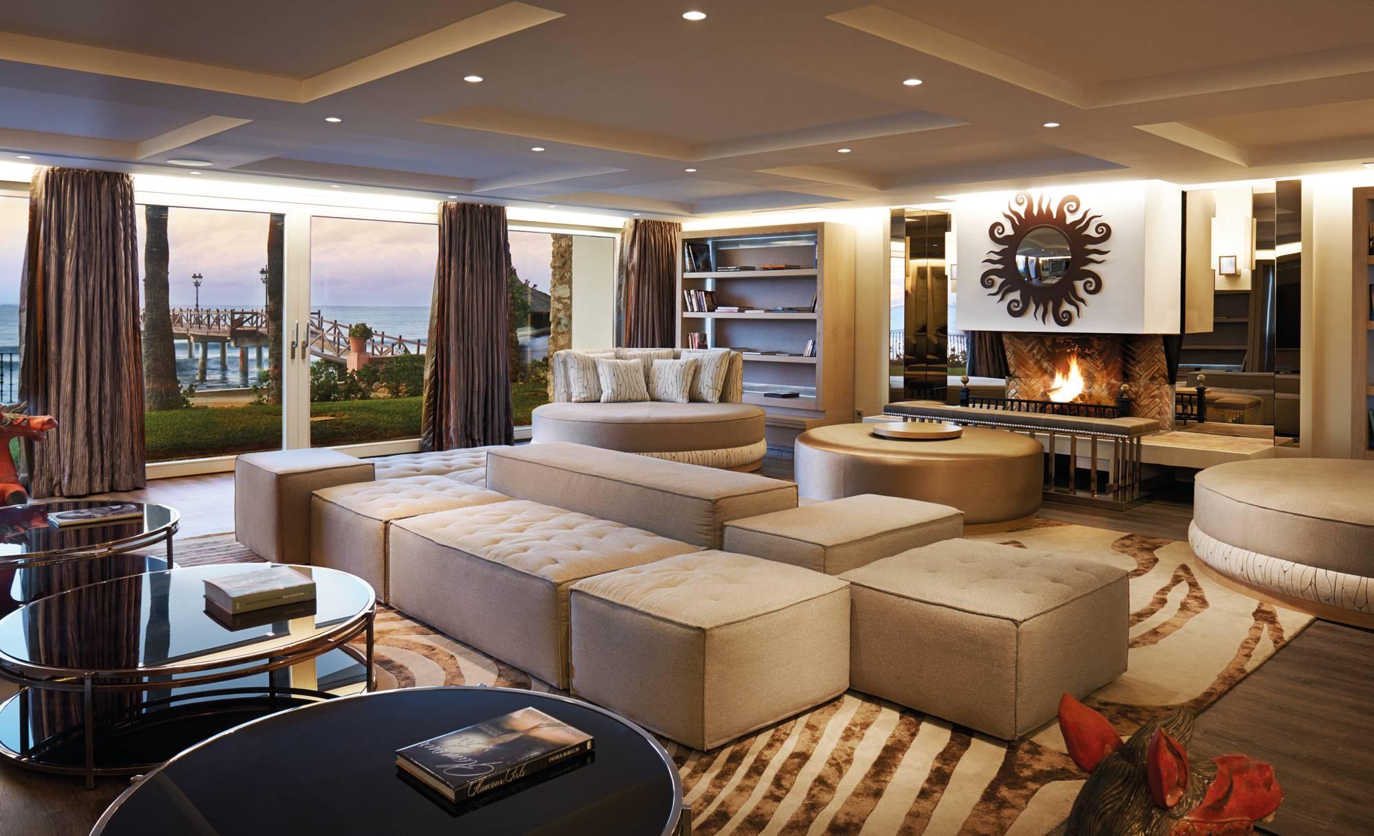 Marbella Club Villa del Mar - Basement Livingroom fireplace
